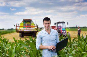 bigstock-farmer-with-laptop-during-harv-94008128